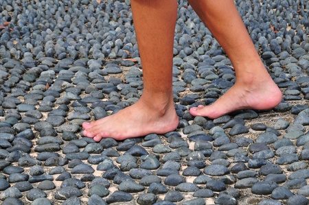 Walking Bare Footed On A Cobblestone Surface