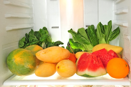 Fresh Fruits And Vegetables In A Refrigerator Stock Photo - 9782306