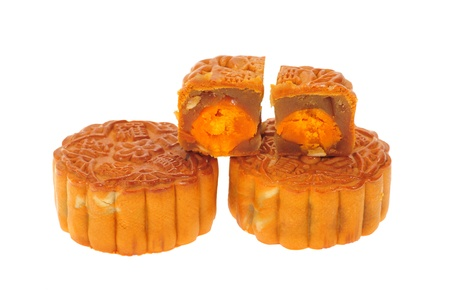 Chinese Moon Cakes With Sectional View Showing The Ingredients photo