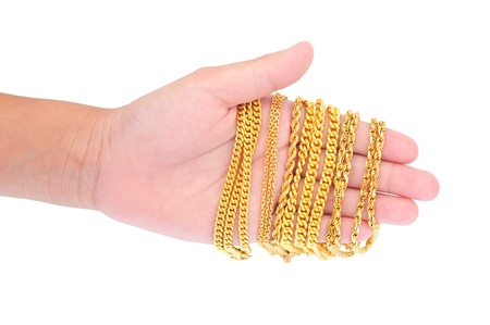 Hand Holding Gold Jewelry