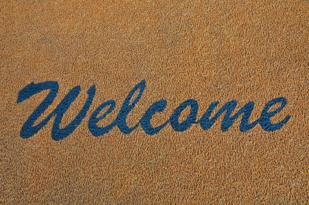 Blue Welcome Sign On A Carpet photo