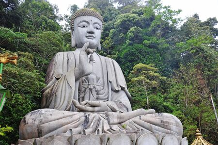 Stone Buddha Statue In Meditation Pose photo