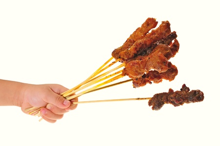 Hand Holding Barbecue Meat, Satay photo