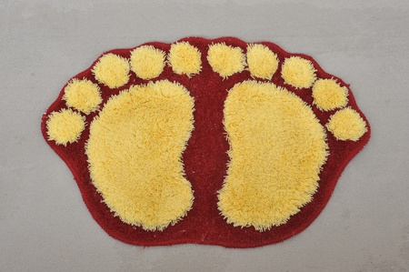 Door Mat With Foot Print Design Stock Photo - 12365370