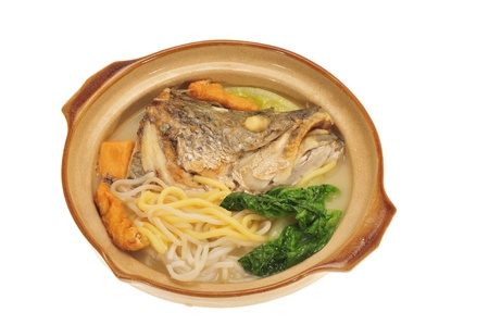 Serving On Claypot Fish Head Noodle photo