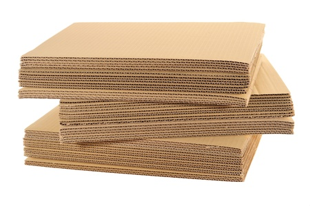 corrugated cardboard:  Stack Of Corrugated Board Isolated On White Background Stock Photo