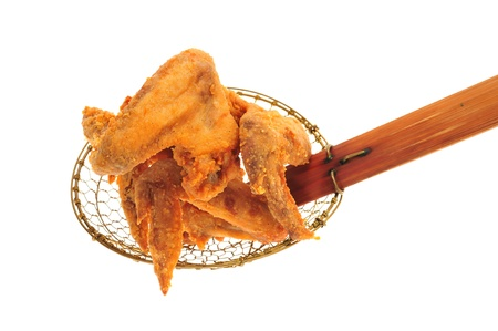 strainer: Fried Chicken Wings On A Kitchen Strainer