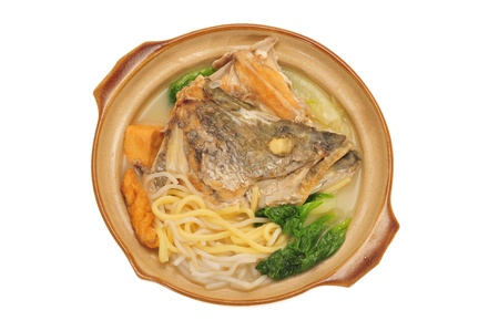 Fish Head Noodle Served In A Claypot photo