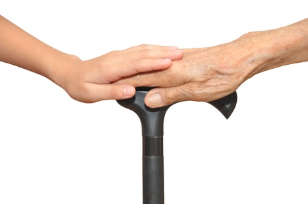hand grip: Old And Young Hands  Holding Onto A Walking Stick
