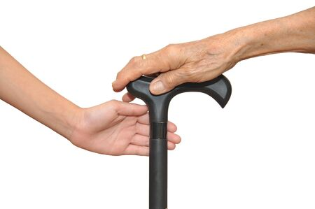 Old And Young Hands Holding Onto A Walking Stick Stock Photo - 17016488