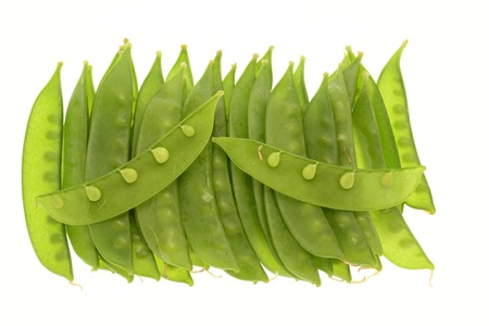 species of creeper: Green Peas Isolated On White Background Stock Photo