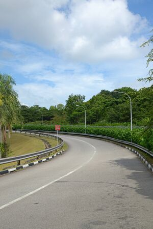 sharp curve: Curving Road Up The Hill