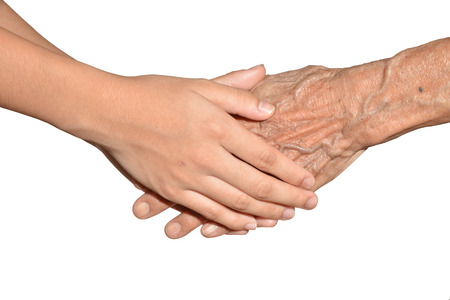 Young Hands Grasping Old Hands Stock Photo