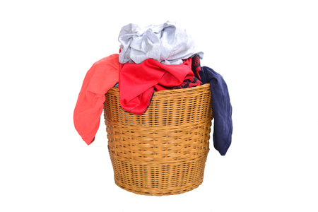 filthy: Laundry Basket Filled With Clothing Stock Photo