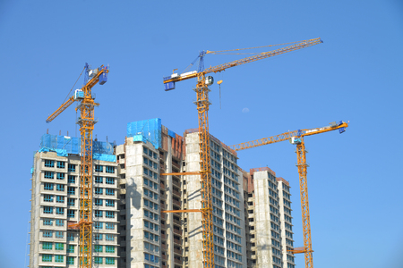 uncomplete: High Rise Buildings Under Construction With Tower Cranes Stock Photo