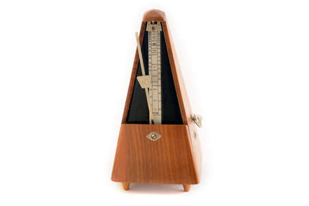 Old classic metronome isolated on white background
