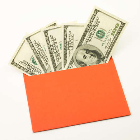 Money in red envelope. One hundred bills. Unofficial salary. Fan of dollars closeup
