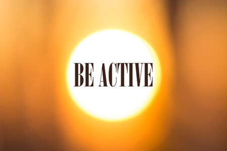 Be active words. Motivation phrase on sunny blurred background