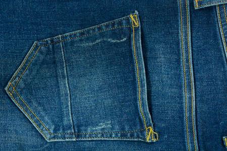 Pocket jeans texture closeup. Blue textyle modern background. Piece of cloths