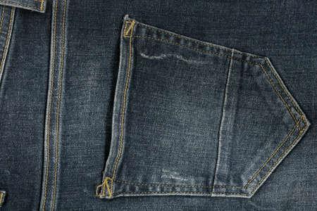 Grey jeans background closeup. Textyle modern texture. Piece of cloths - back pocket