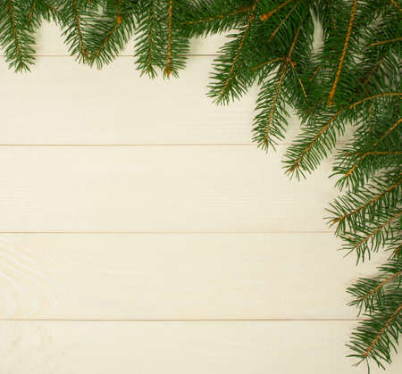 Christmas tree framework branches on wooden background with copy space. Horizontal template top view for design