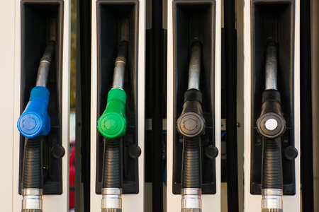 Gas pump on gasoline station. Fuel and diesel equipment - nozzle closeup front view in blue, green, black colors