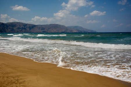 Clean sandy Georgioupolis beach, azure Mediterranean sea, mountains on the horison Reklamní fotografie