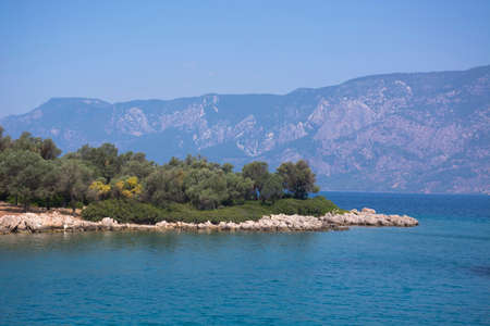 Aegean Islands on mountains and blue sky background, Turkey. Tropical wallpaper, paradise beach for travel