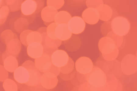 Coral tone bokeh blurred background. Abstract creative pink bokeh background for design Imagens
