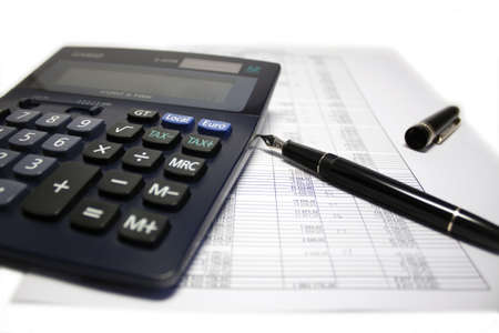 Calculator, fountain pen and balance sheet isolated on white background