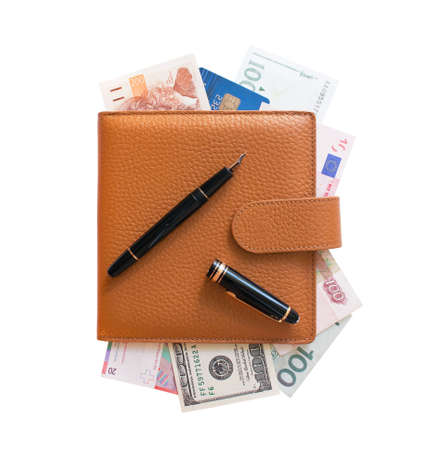 Beige organizer filled with different currencies isolated over white background. Black fountain pen. No trademark. View from above. photo