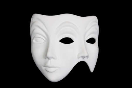 Double face white mask isolated over black background