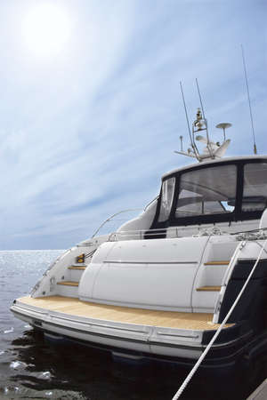 Rear view of white luxury yacht, blue sky and sea Stock Photo