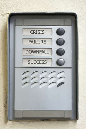 Modern doorbell plate with crisis failure downfall success buttons. Success button looks used.