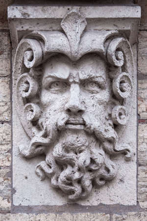 greek statue: Face of a man with beard, stone sculpture