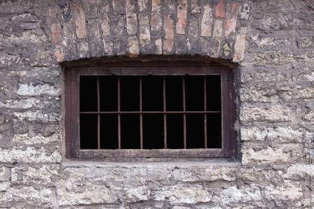Old rusty prison window. Brick wall Stock Photo - 5385860