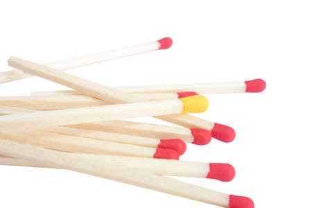 Bunch of red matches and one yellow isolated over white background