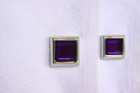 Two violet silver cuff links perspective view