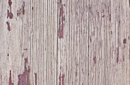 Closeup of old wooden door, aged red paint. Texture. Stock Photo
