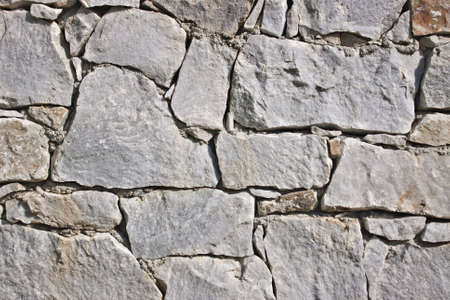 Closeup of old stone wall, marble and granite. Texture.