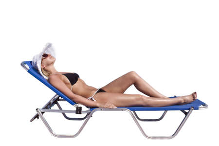Young blond white woman lying on blue sunbed isolated over white background