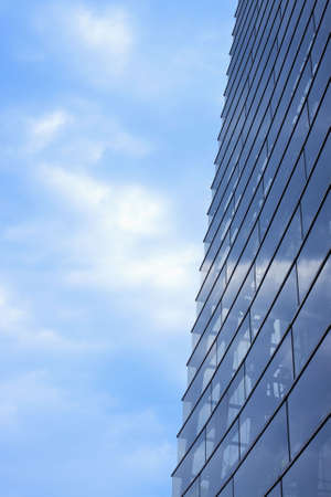 Modern office building and blue cloudy sky as background