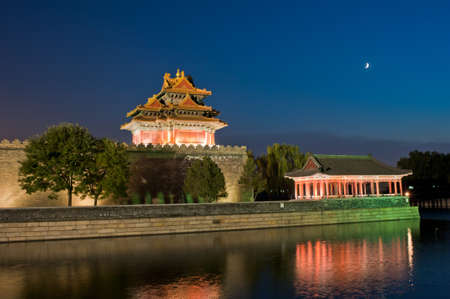Watchtower and the moon in th enight of Beijing Stock Photo - 14137574