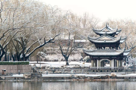 Chinese pavilion in the snow, a park of Beijing photo