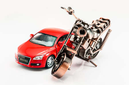 A motorcycle and a red color car model