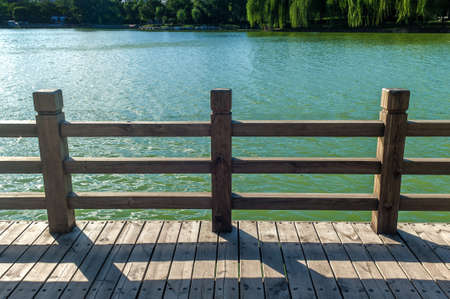 guardrail: Wooden guardrail at the lakeside