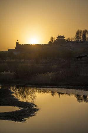 jiayuguan pass tower: Sunset in Jiayuguan, west end of Great Wall, Gansu of China