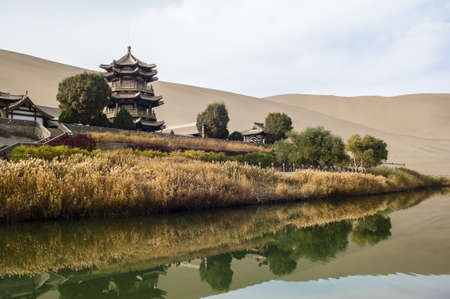 Crescent Spring and Mingyue Pavilion in the morning, Dunhuang of China Editorial