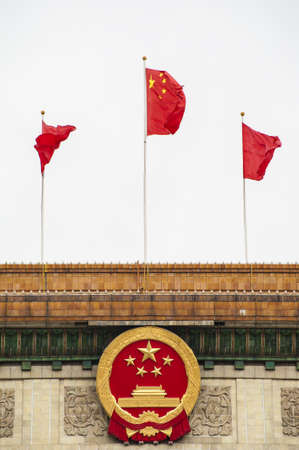 Chinese national emblem and flag on the building Stock Photo