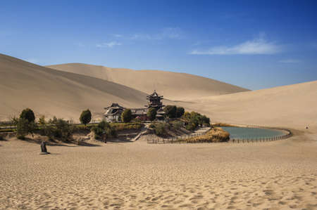 Scene of Crescent Spring and Mingyue Pavilion, Dunhuang of China photo